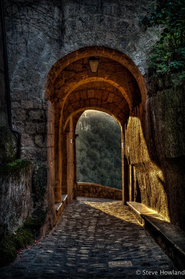 Setting sun catches the entrance to Civita di Bagnoregio